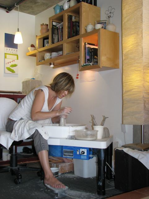 Melanie Mena in the pottery studio